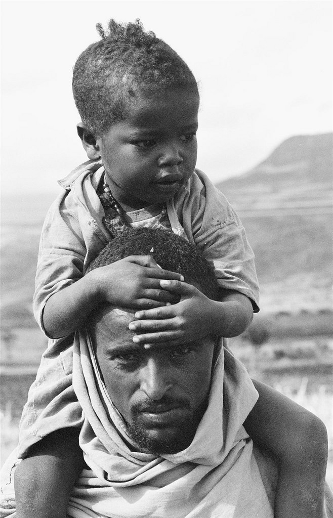 child on shoulders